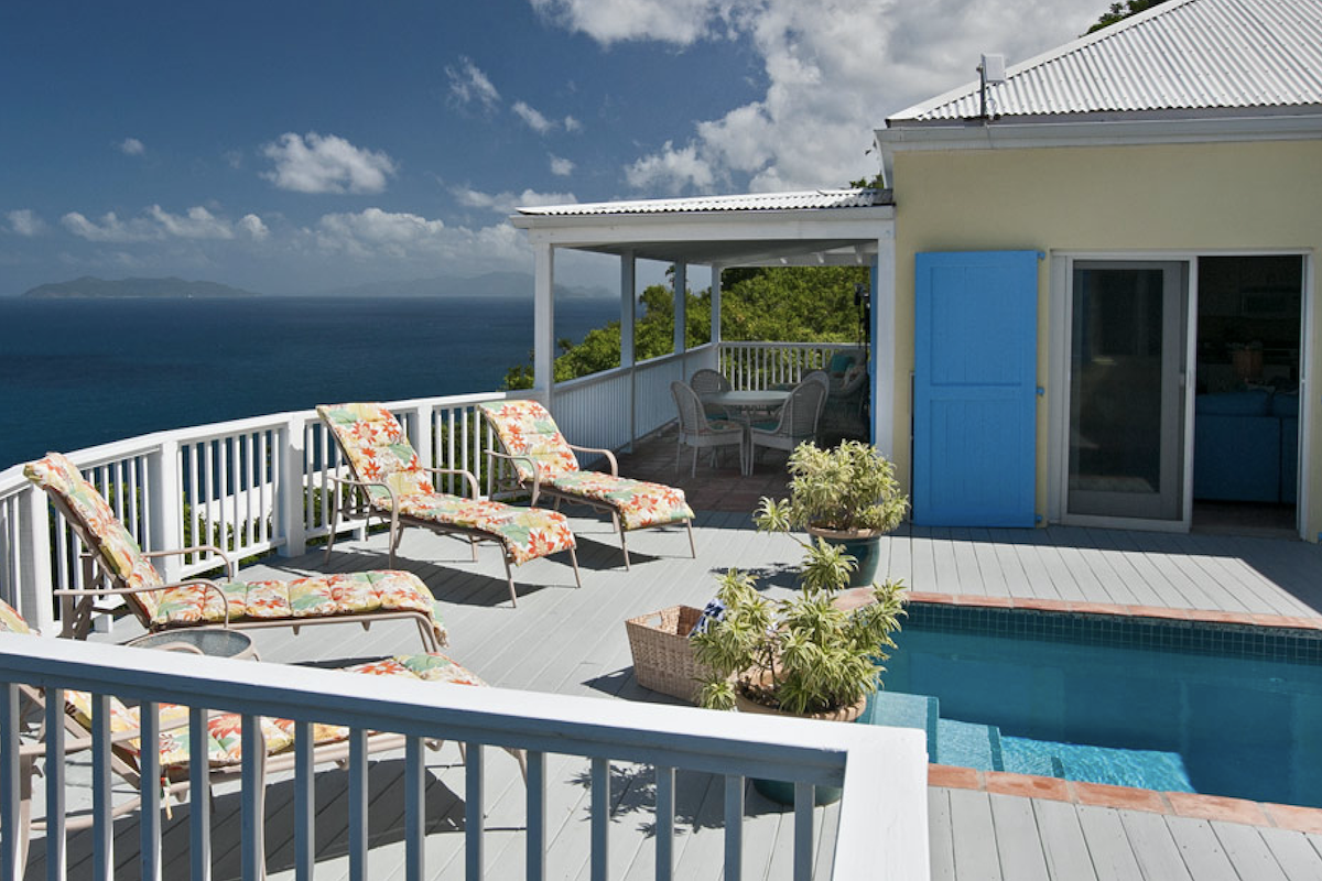 Lounge poolside and take in the views of the ocean
