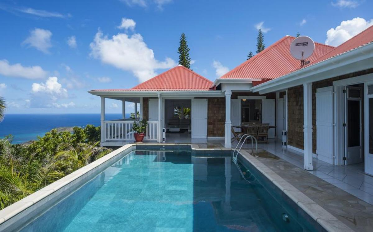 Step right out of your villa to the pool deck with amazing ocean views