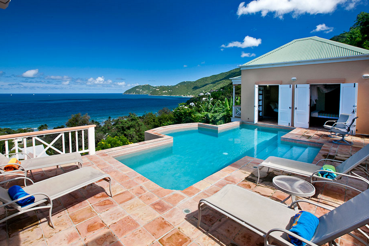 Relax by the pool with views of the caribbean at Murray House