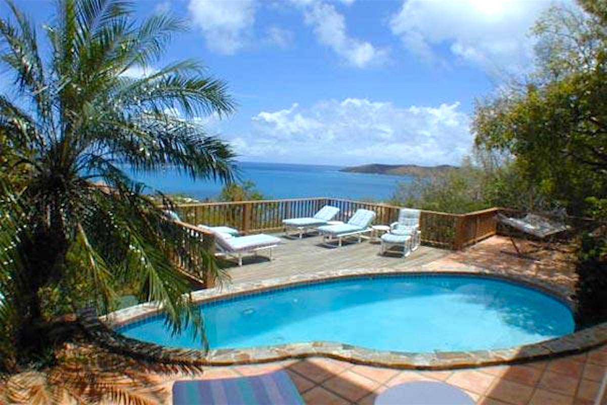 Views of the caribbean through the tropical landscape at Sea Dream villa