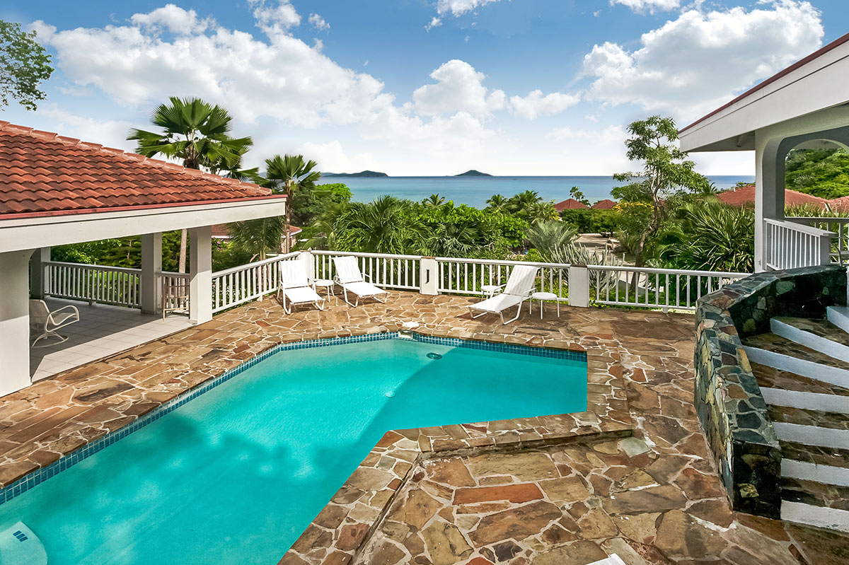 Pool and patio at Cool Runnings Villa