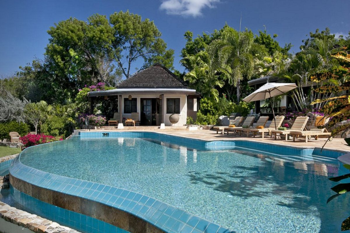 Luxurious resort style pool in a lush tropical setting at Sol y Sombra