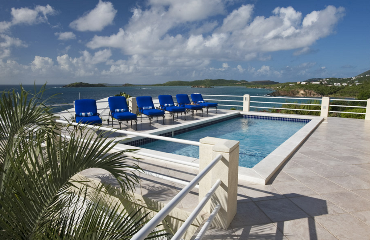View to the ocean from the pool at Blue Serenity villa!