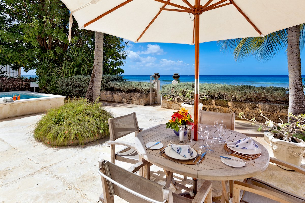 Enjoy dining and cocktails while the surf hits the shore only a few feet away