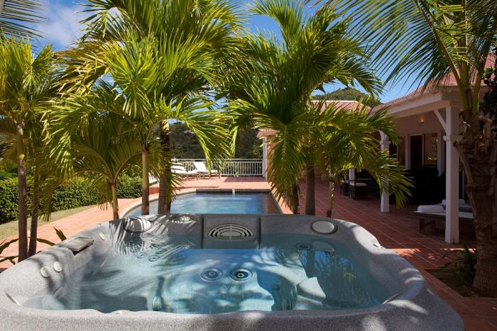 Jacuzzi hot tub overlooking the swimming pool