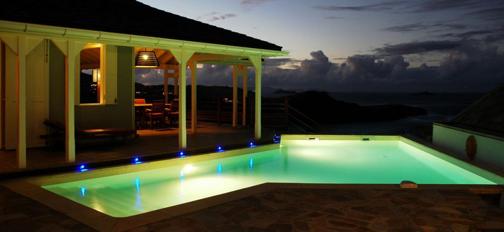 Illuminated pool at sunset