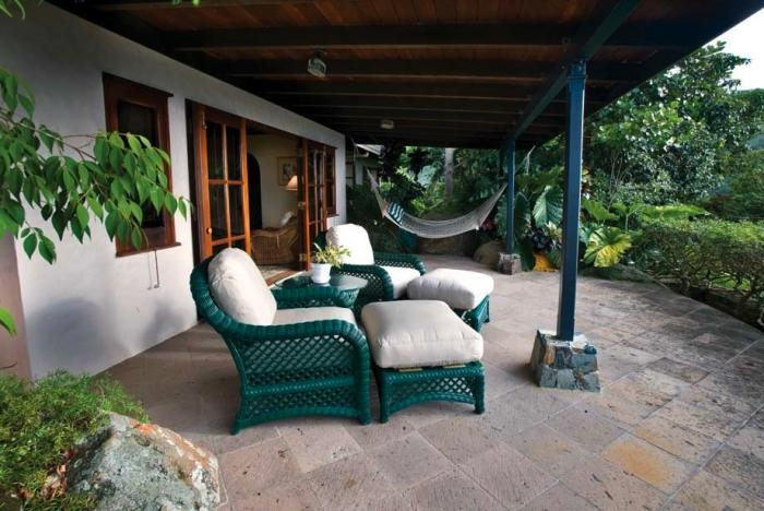 Terrace with patio chairs and hammock.
