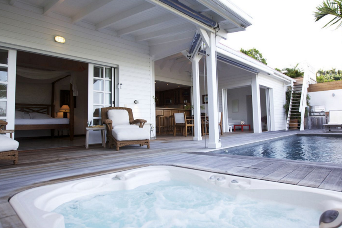Relax in the hot tub or take a refreshing dip in the pool at Piment Villa