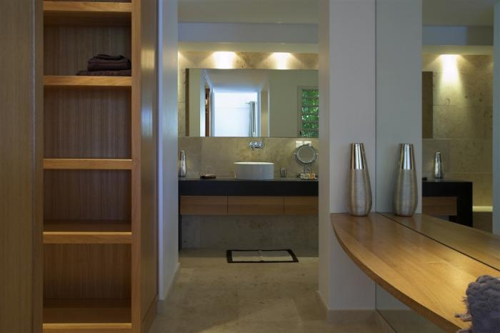 Ensuite bathroom with a large dressing area.