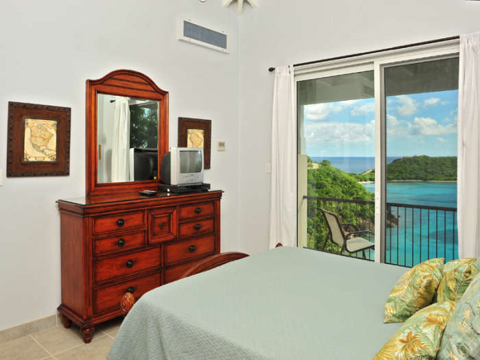 Bedroom 2  enjoys ocean views and balcony access