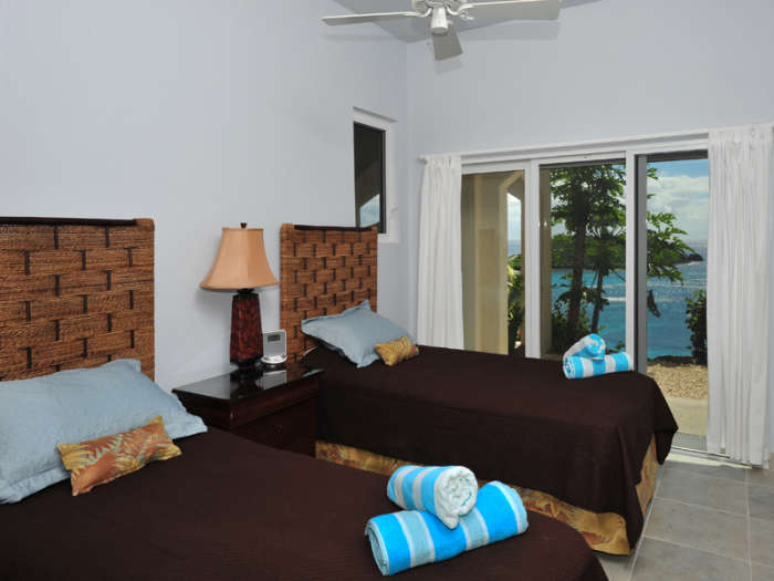 Bedroom 4 offers two twin beds and ocean views
