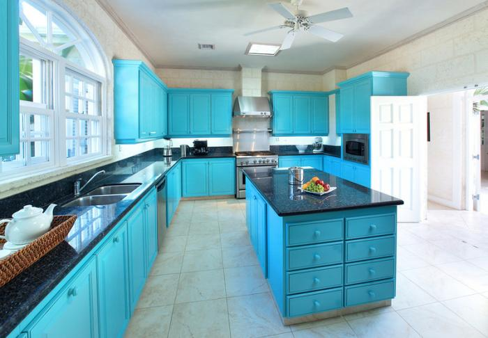 The kitchen is fully equipped and includes granite countertops and an island