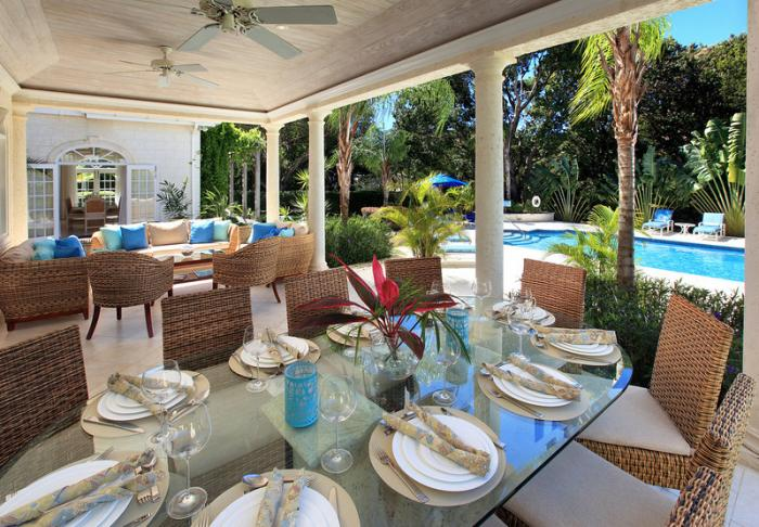 The veranda offers outdoor dining and lounge areas