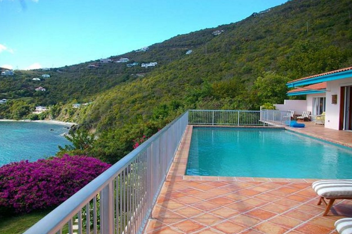 This hillside villa has beautiful views from the pool deck!