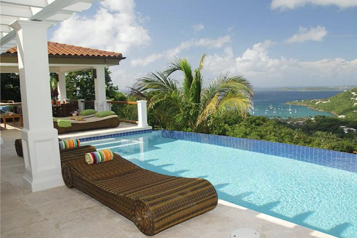 Relax and enjoy the amazing view poolside from Abrigado Villa