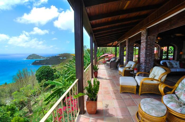 Views to the lush tropics and ocean off the balcony.