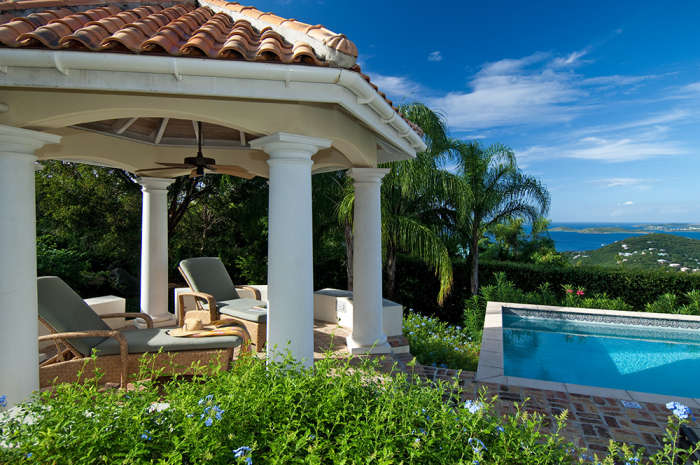Wonderful poolside gazebo with chaise lounge chairs.