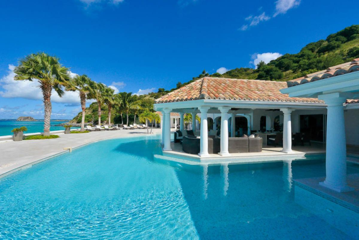Luxurious pool and patio at Petite Plage 4 Villa
