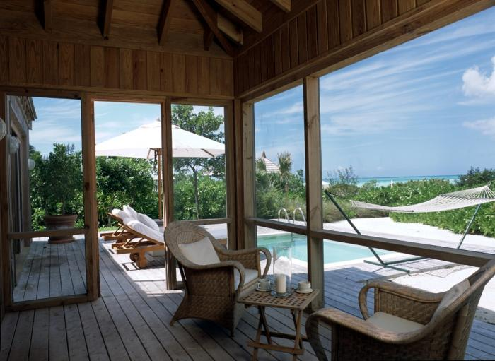 Parrot Cay Resort- Beach Houses Deck and pool with hammock. image, Turks and Caicos