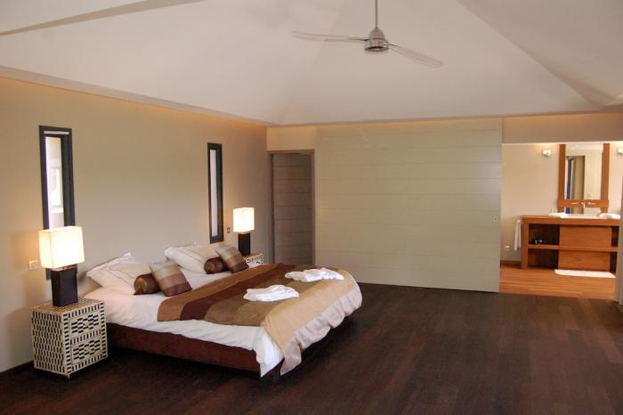 Spacious master bedroom with king bed and ensuite bathroom.