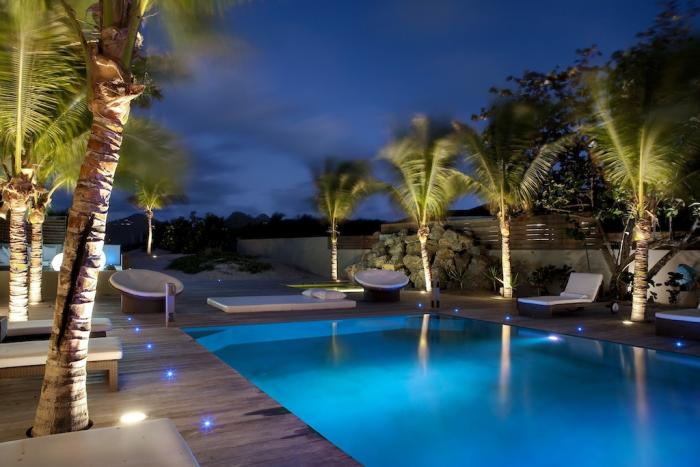 The pool lights up beautifully at night.