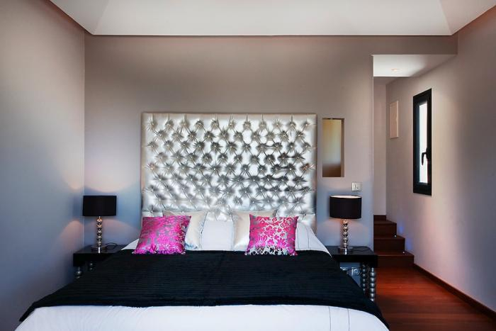 Queen bed and tufted headboard.