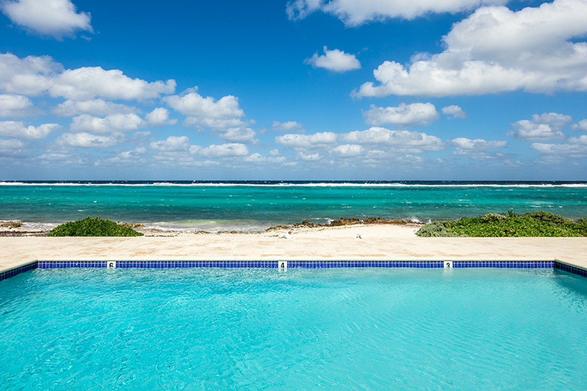 Stunning ocean views from the pool at Thatch Hill Villa