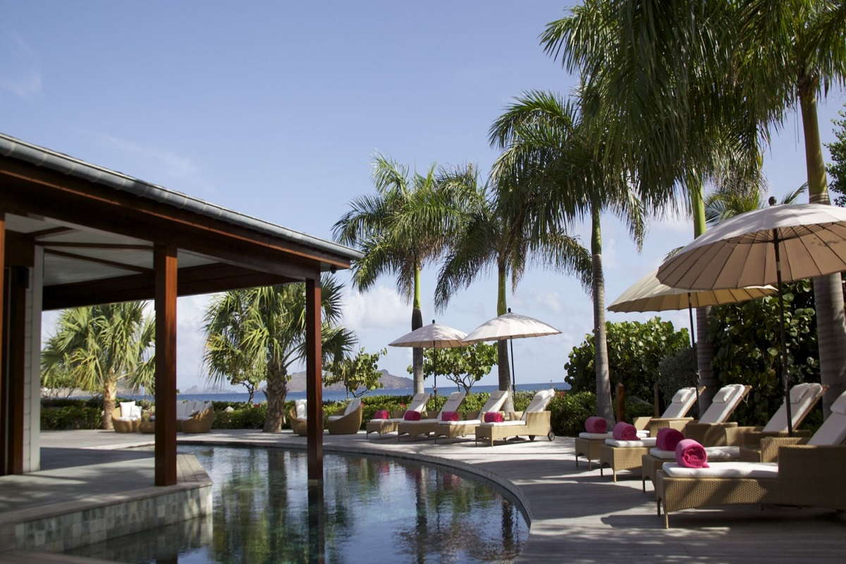 Relax by the pool and enjoy island luxury at La Plage Villa