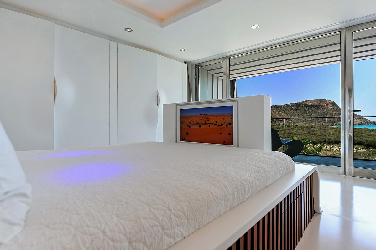Retractable television at the foot of the bed