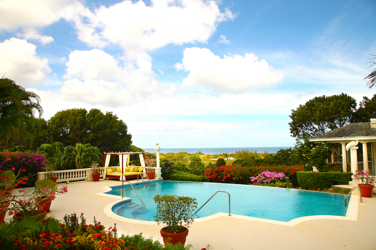 Views of the ocean in the distance and tropical landscaping around the