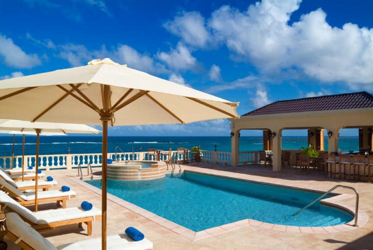 Beautiful pool deck and views of the ocean at Ultimacy Villa