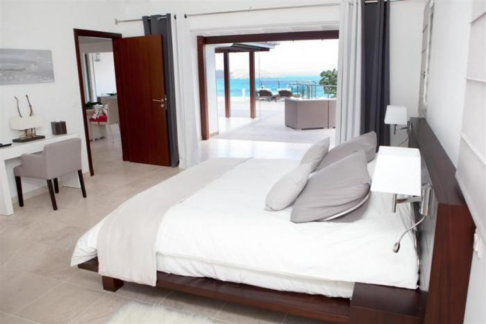 Bedroom with outdoor access and ocean views.