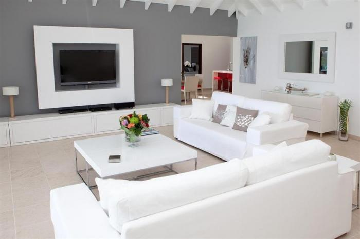 Living room with seating and television equipped with satellite television.
