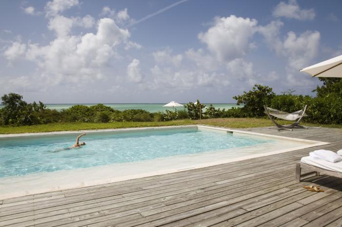 Sundeck and heated swimming pool at the Two Bedroom Beach Villas!