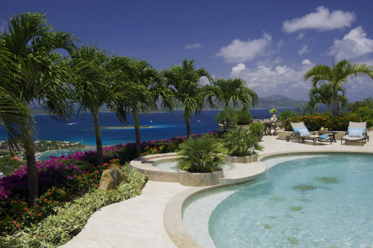 Palms surround the private pool with spectacular views of the carribean