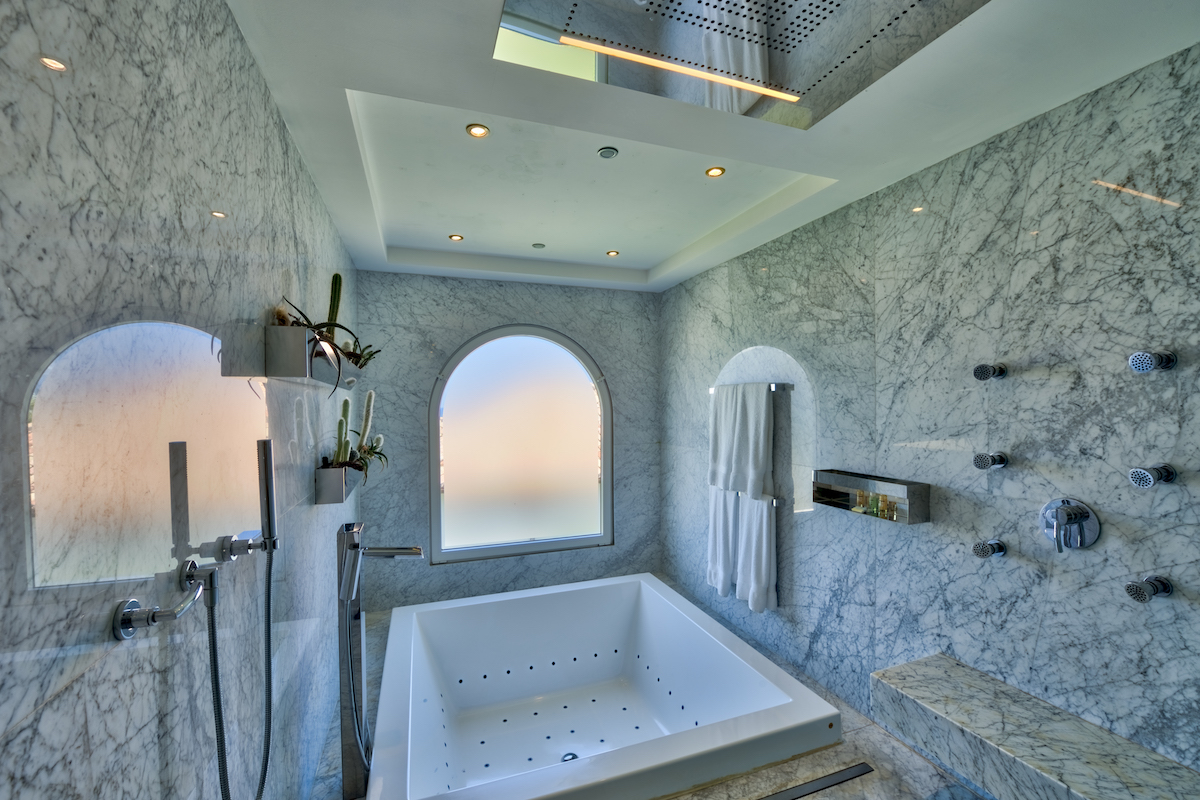 Bathroom with jetted tub and multi head shower