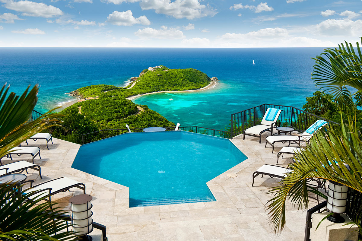 Impressive views of the Caribbean from the pool and deck area at Island Rider Villa