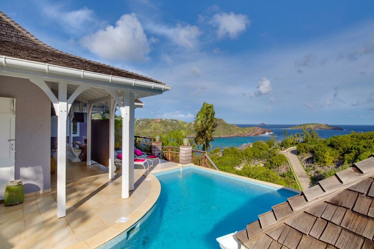 Relax and enjoy the tropical sun lounging by the pool with views of the Caribbean from Lagon Jaune