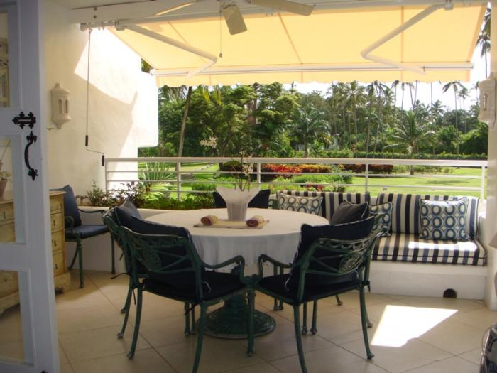 Balcony dining with seating for up to six.