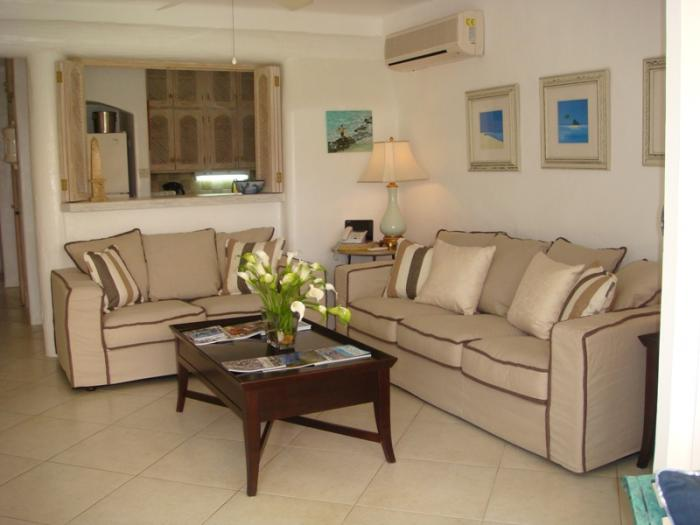 Living room with three and  two seater sofas.