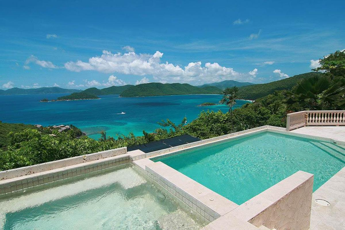 Beautiful views of the Caribbean from the pool and hot tub at Lantano villa