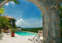 Stone archway with views to the pool