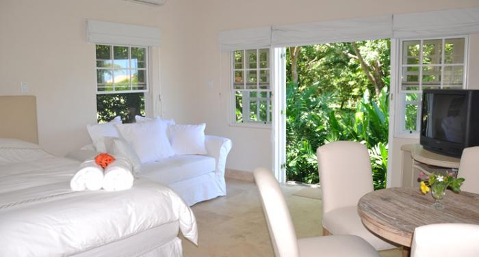 The second bedroom opens out to the gardens