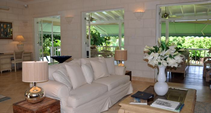 The living room opens out onto the covered terrace