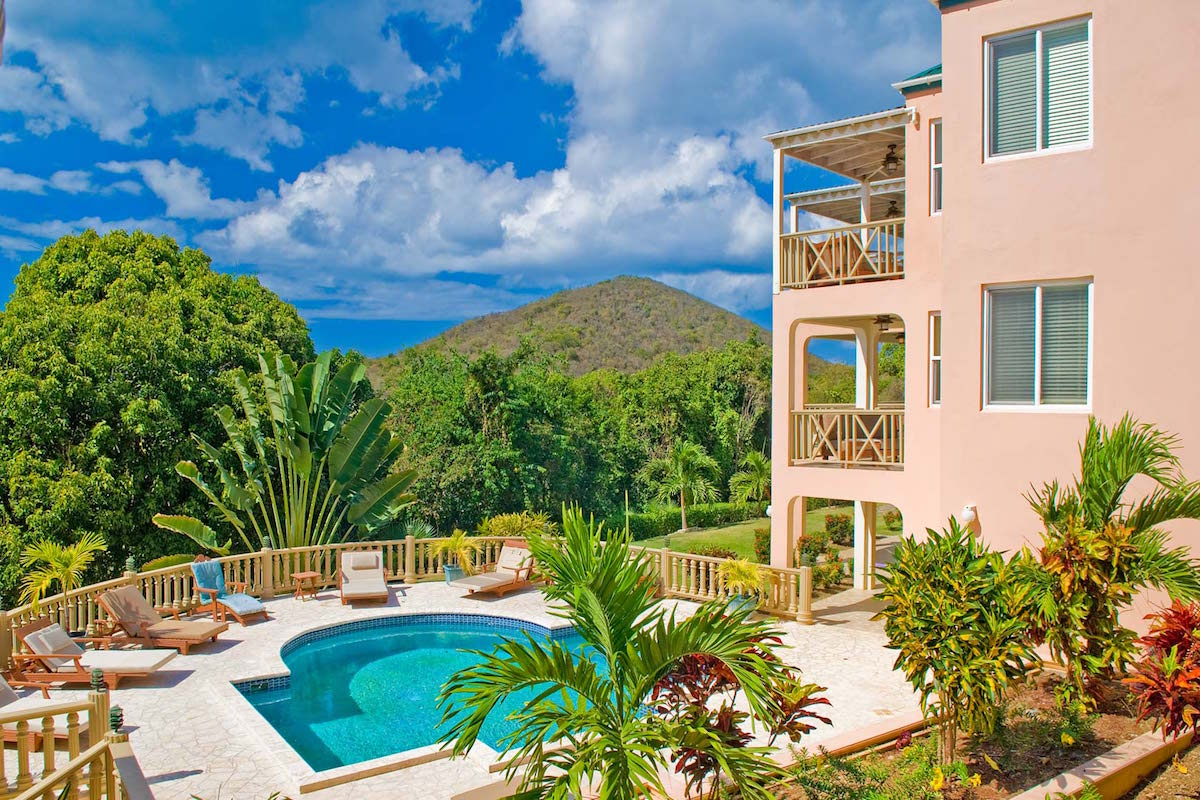 Lush tropical greenery surrounds this idyllic caribbean Villa