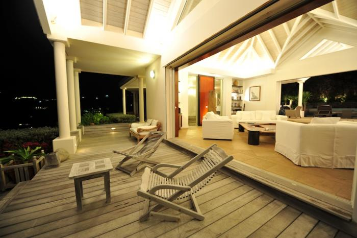The deck and living area at night.