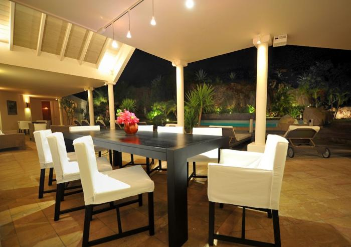 Dining view out to the pool at night.