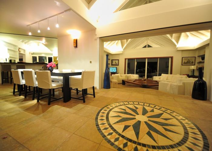 The dining and living area at night.