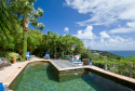 The pool is situated in a beautiful tropical setting at Kyody Villa