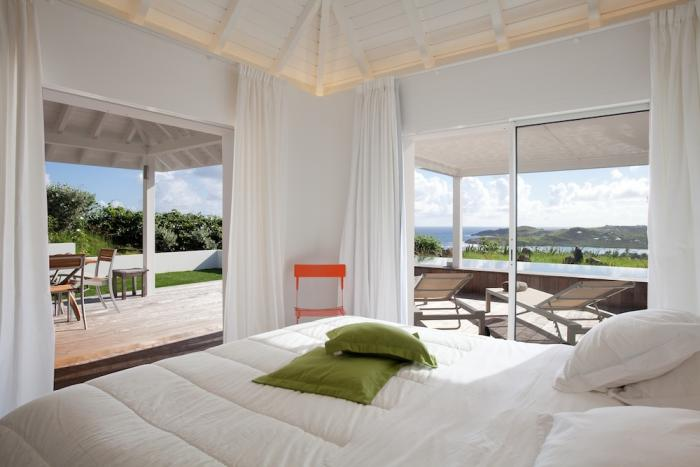 Bedroom with access to the terrace and pool.